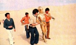 C3pO being carried in the desert