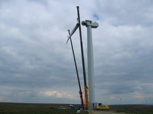 crane putting up a wind turbine